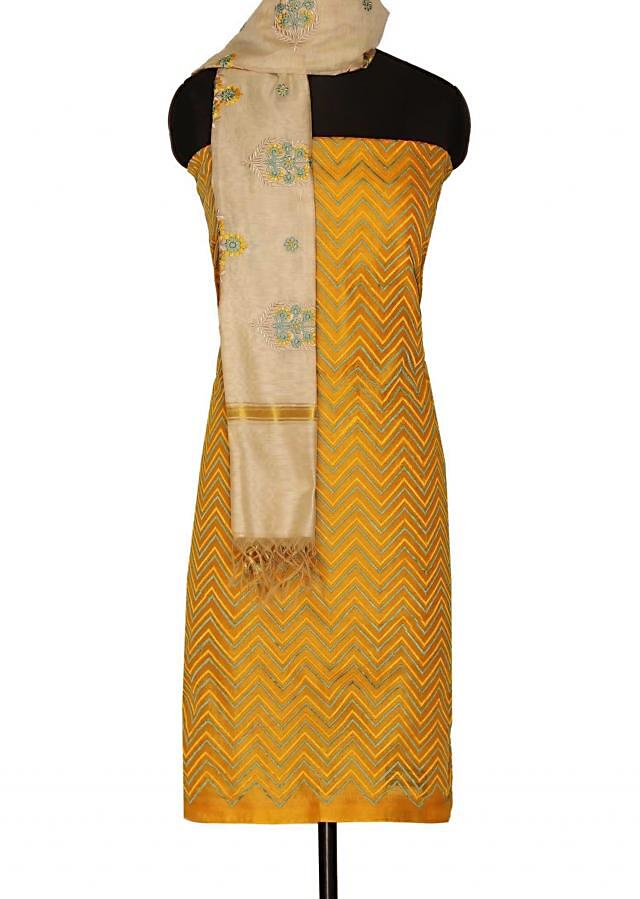 Chrome yellow unstitched suit with beige dupatta only on Kalki