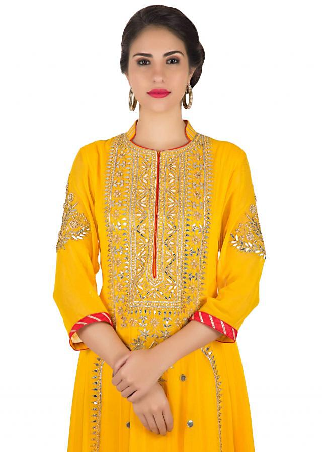 Chrome yellow anarkali suit with embroidered placket and kali only on Kalki