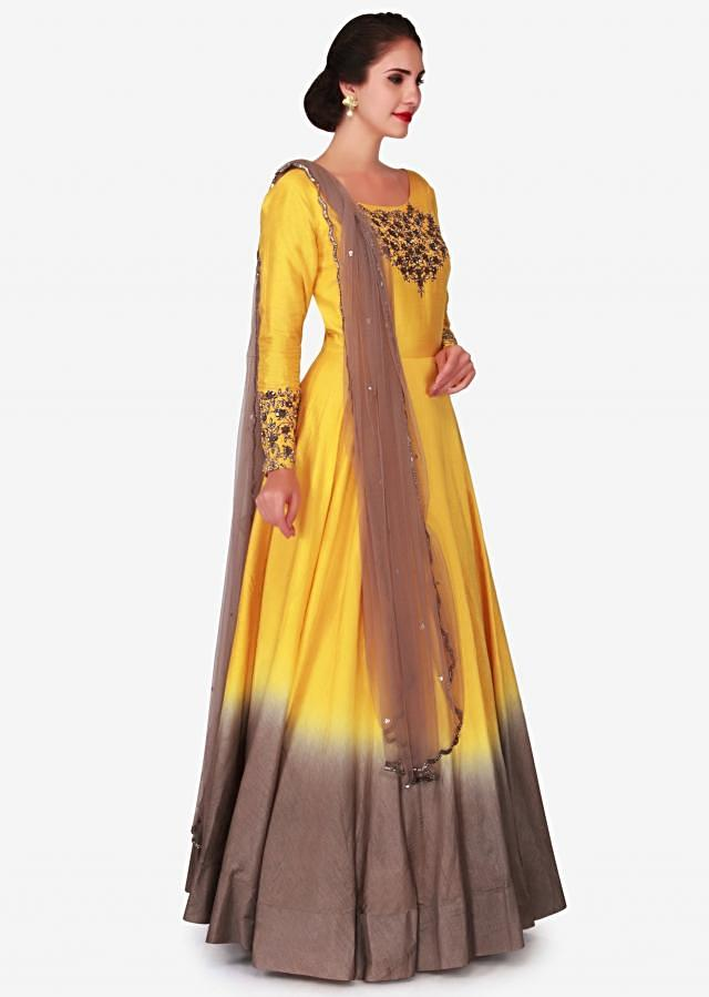 Chrome yellow and grey shaded anarkali suit with embroidered neckline and sleeve only on Kalki