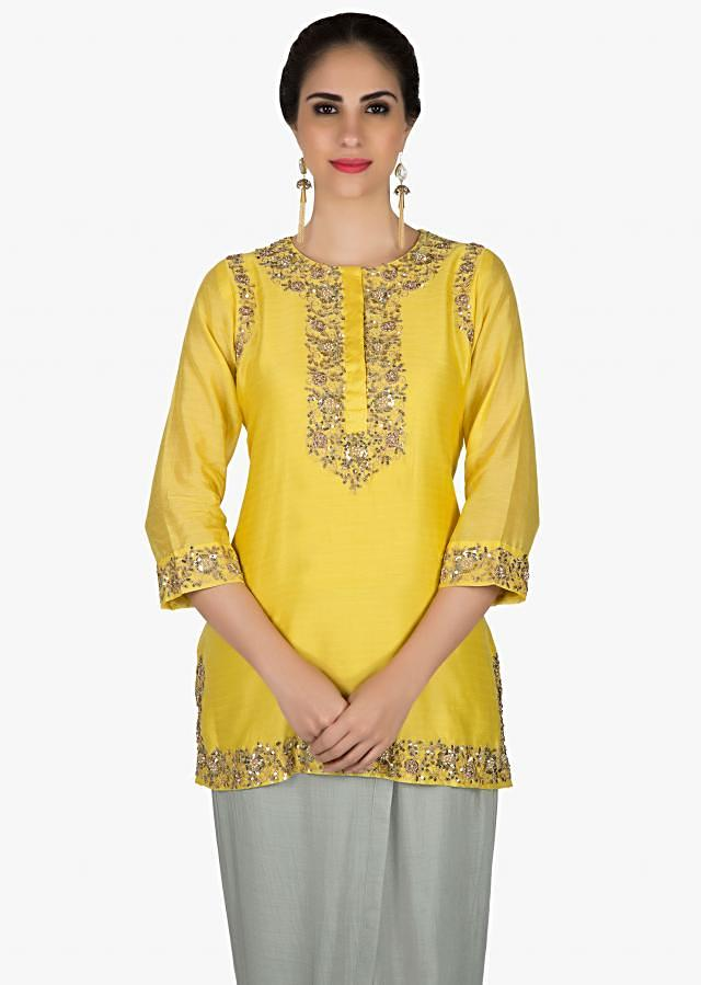 Chrome yellow suit in embroidered placket matched with dhoti pants only on Kalki