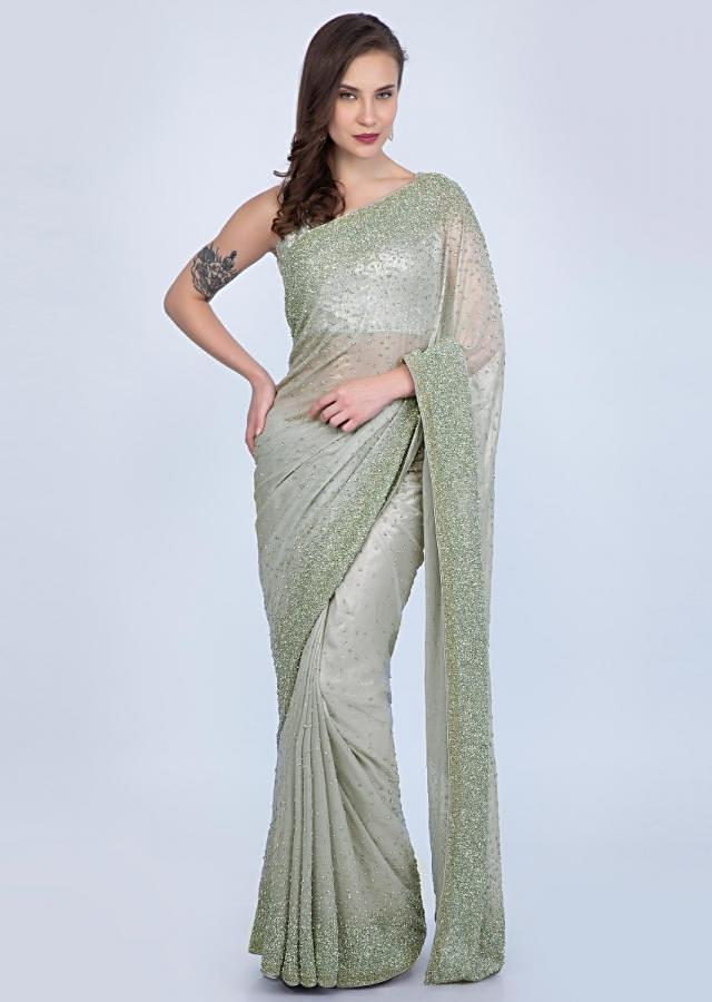 Cloud grey shimmer georgette saree with heavy sequins embroidery only on Kalki