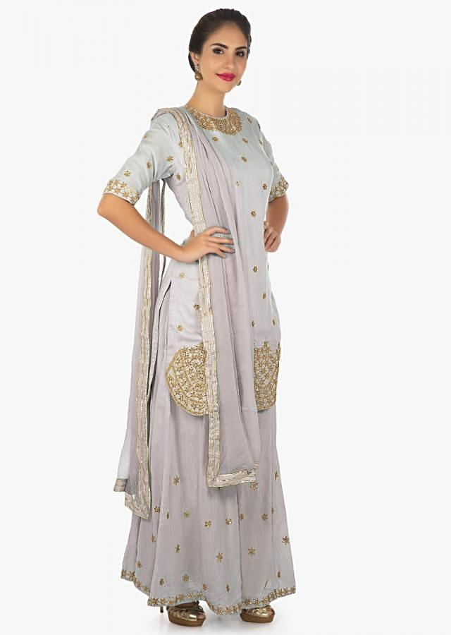 Coin grey cotton palazzo set styled paired with a chiffon dupatta only on kalki