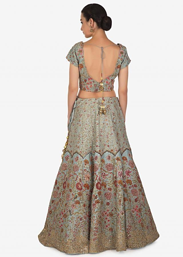 Coin grey lehenga adorn in resham and sequin work in floral motif only on Kalki