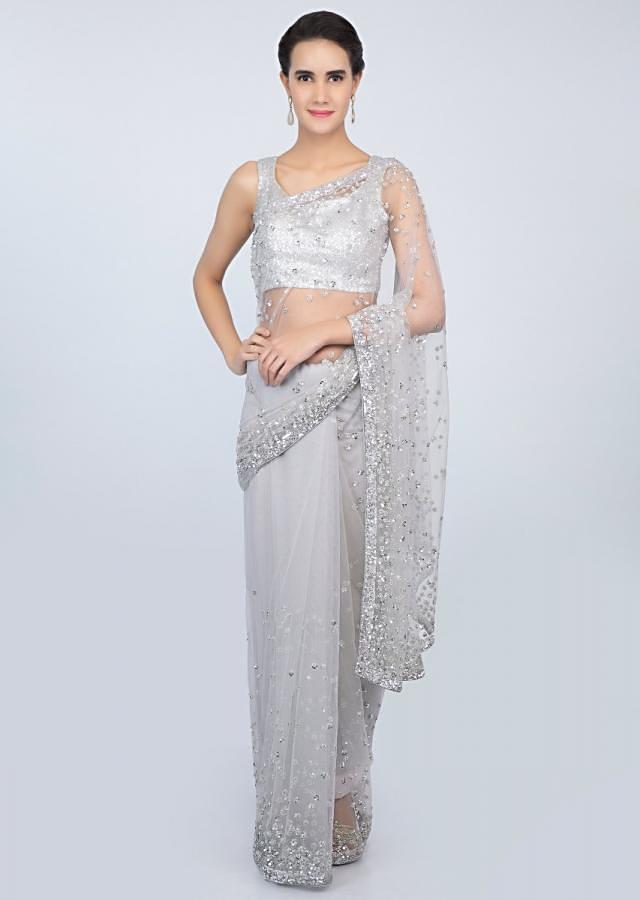 Coin grey sheer net saree with sequins embroidered butti and border only on kalki
