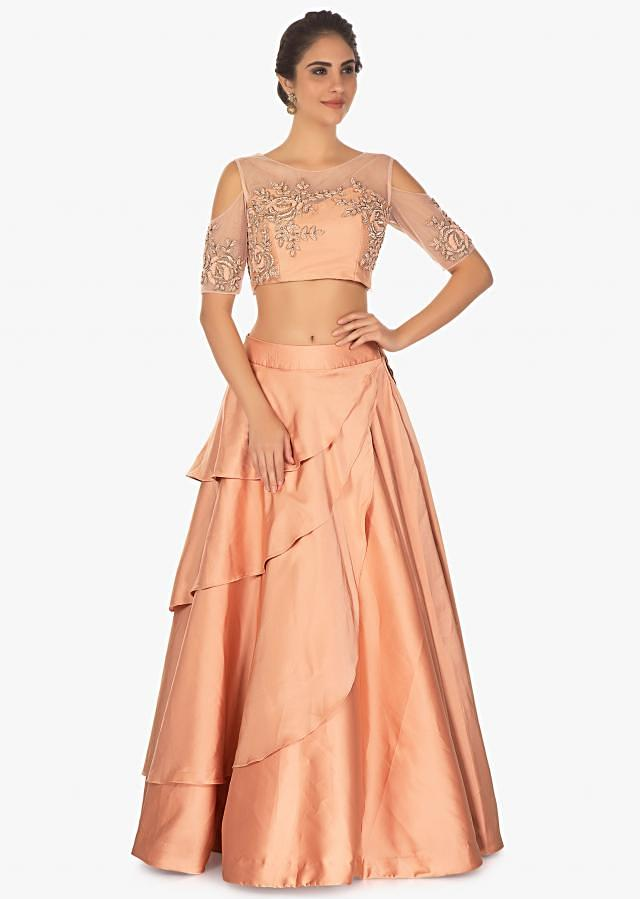Cold shoulder peach crop top with layered satin skirt only on Kalki