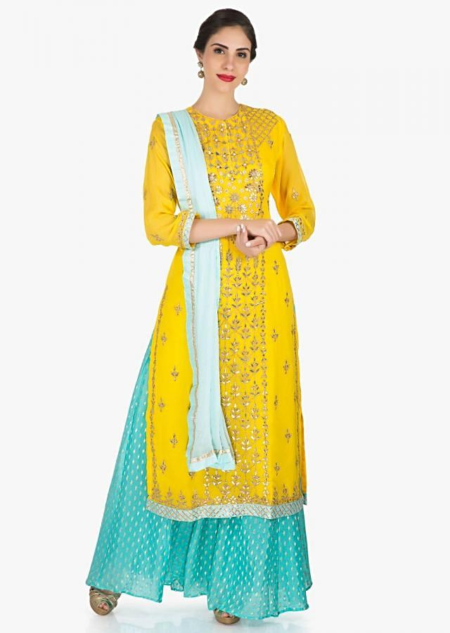 Yellow and blue palazzo suit in georgette featuring the heavy thread and gotapatti work only on Kalki