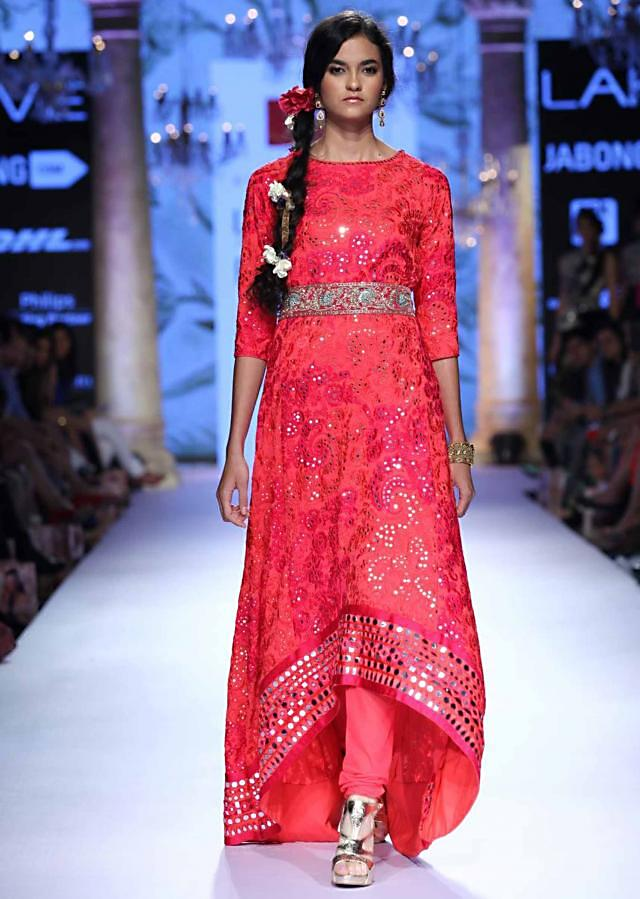 Model in coral anarkali suit adorn in mirror embroidery walks the ramp for Suneet Verma for his collection Decorative Arts of India at Lakme Fashion Week Summer Resort 2015