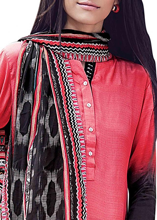 Coral and black shaded kurti with ikat printed scarf