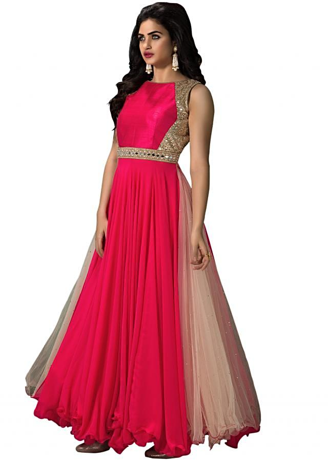 Coral and cream anarkali suit in georgette. Yoke is raw silk in sequin and mirror embroidery. Churidar in lycra and dupatta in net with lurex border.