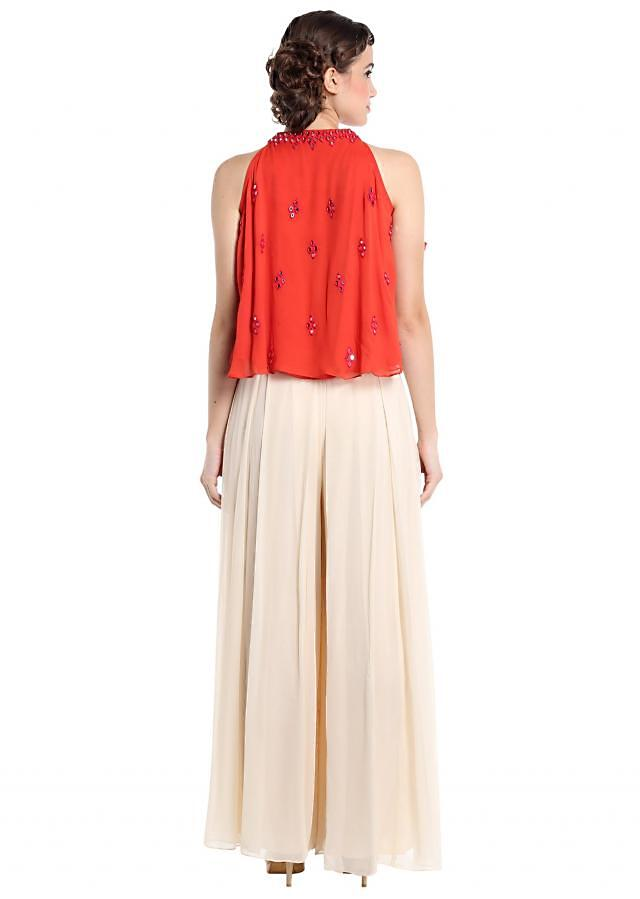 Coral and cream georgette suit crafted with resham and mirror work only on Kalki