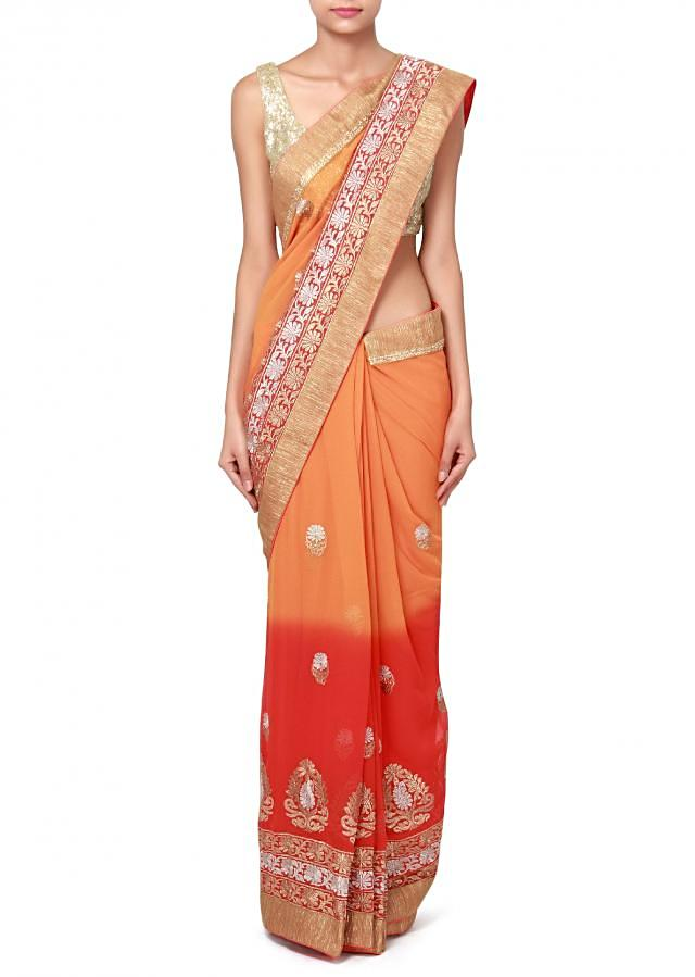 Coral and mustard saree adorn in zari embroidered butti only on Kalki