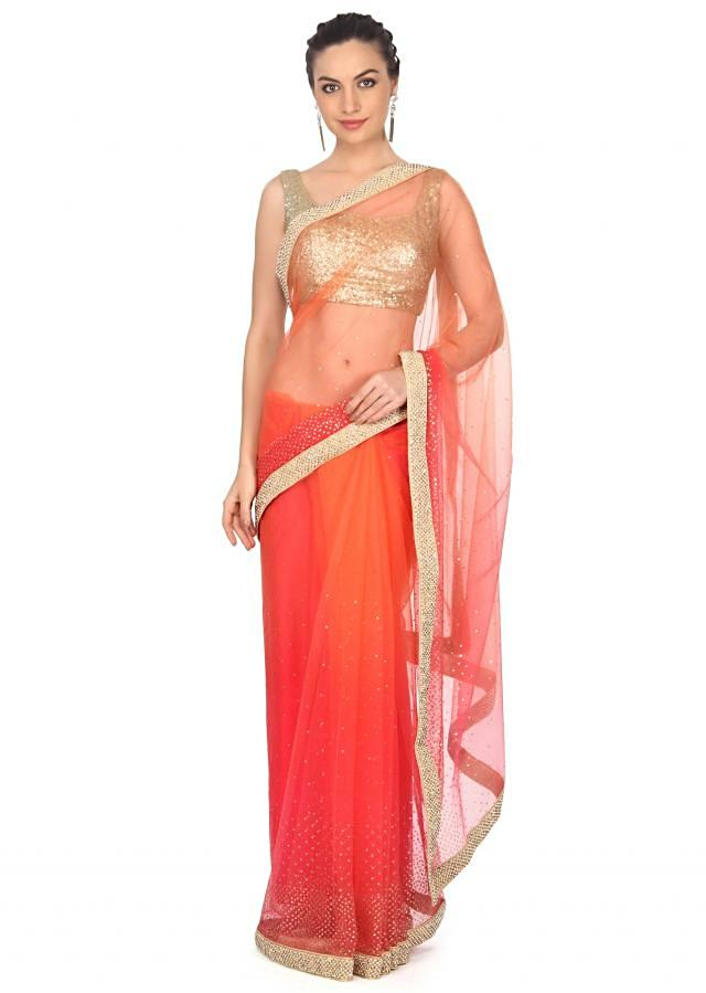 Coral and orange saree adorn in sequin and kardana work only on Kalki
