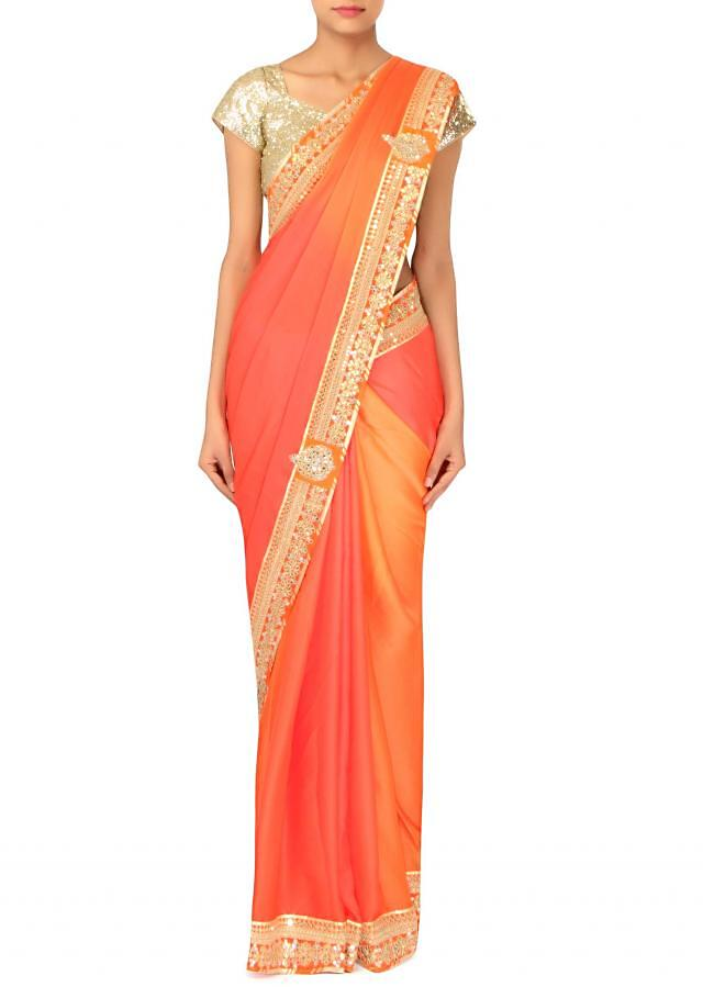 Coral and orange shaded saree in gotta patch embroidery only on Kalki