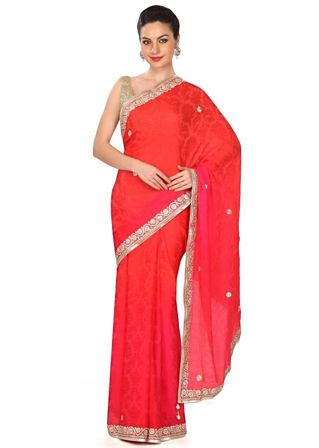 Coral and pink shaded saree in kundan border only on Kalki