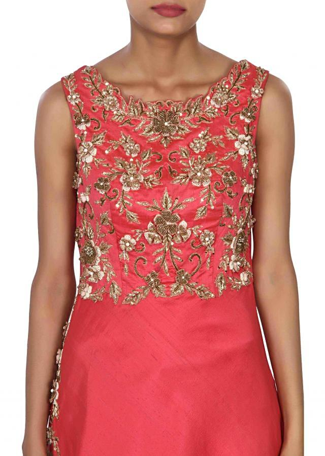 Coral gown enhanced in zardosi and pearl embroidered bodice only on Kalki