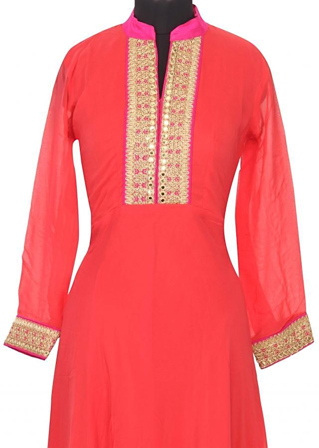 Coral kurti enhanced in embroidered placket only on Kalki