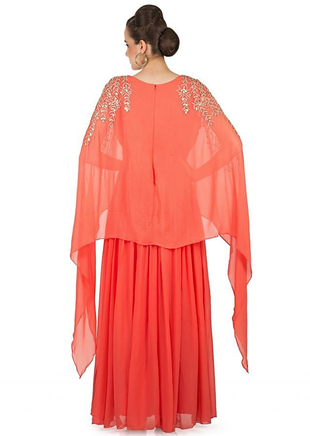 Coral Orange Georgette Gown Styled with a Zari Embellished Cape Only on Kalki