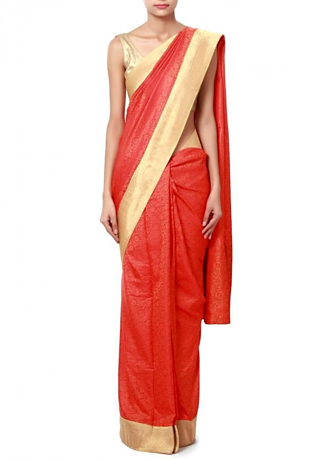 Coral orange saree enhanced in orange weave embroidery only on Kalki