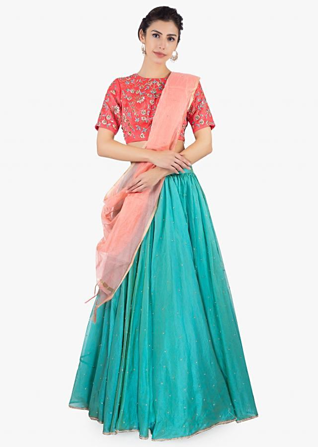 Coral Blouse Inorganza Paired With Jungle Green Shade Organza Lehenga Online - Kalki Fashion