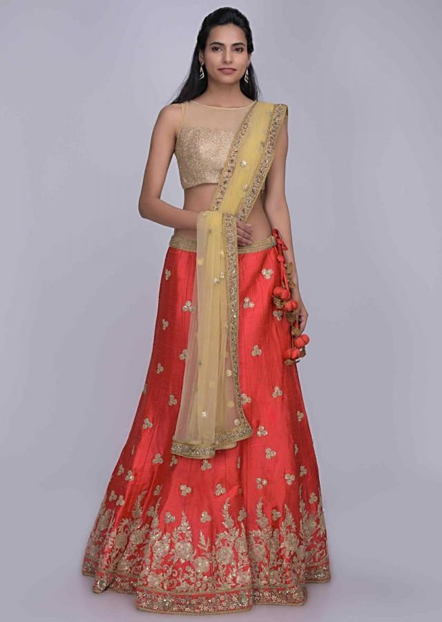 Coral Pink Lehenga Choli In Raw Silk With Golden Net Dupatta Online - Kalki Fashion