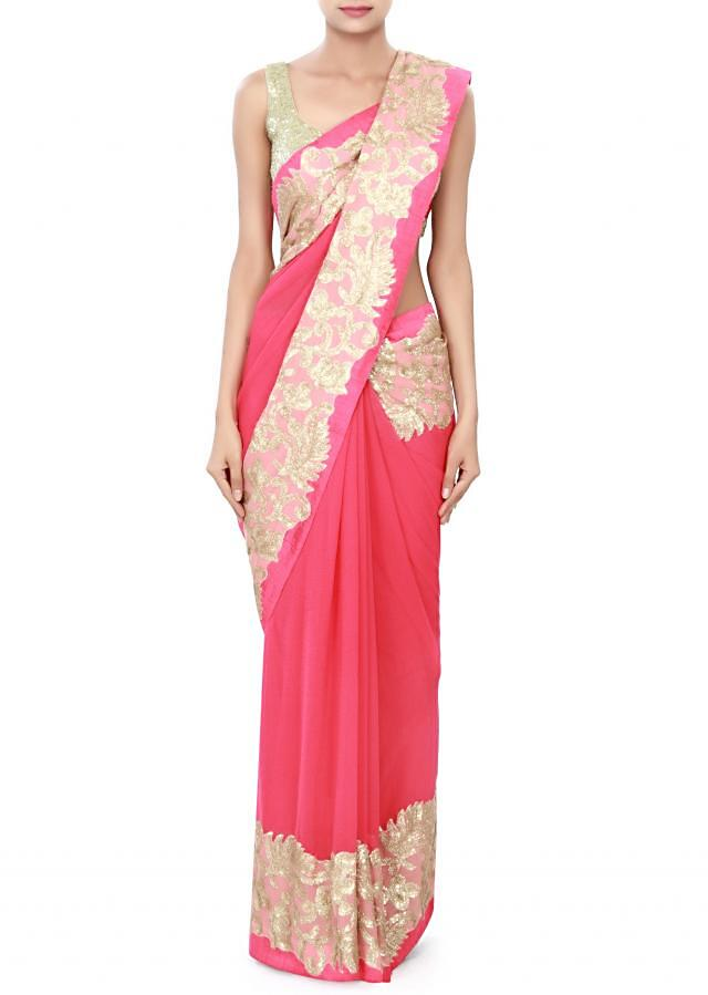 Coral pink saree adorn in sequin embroidery only on Kalki