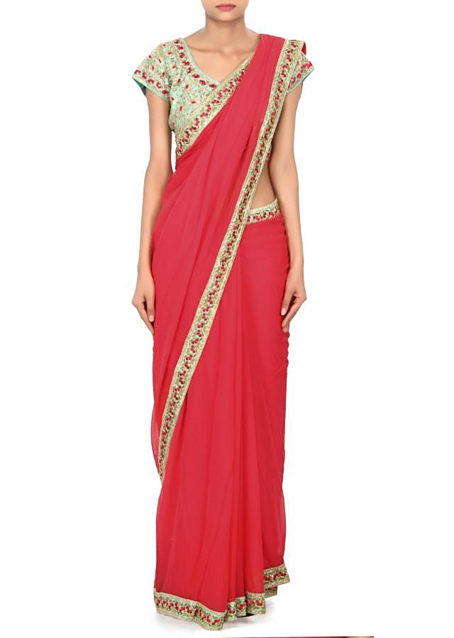 Coral pink saree matched with embroidered blouse only on Kalki