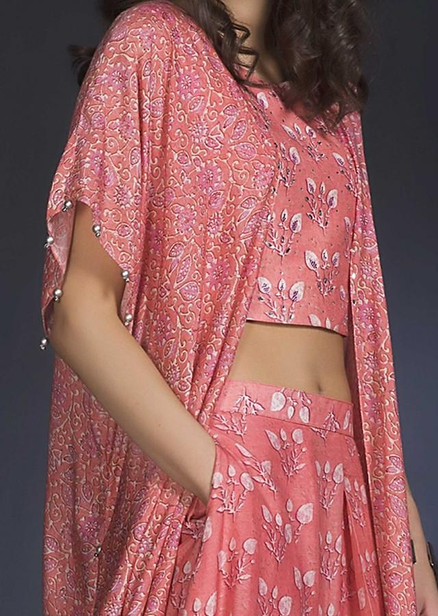 Coral Pink Skirt And Crop Top With Kaftan Sleeves And Printed Leaf Buttis Online - Kalki Fashion