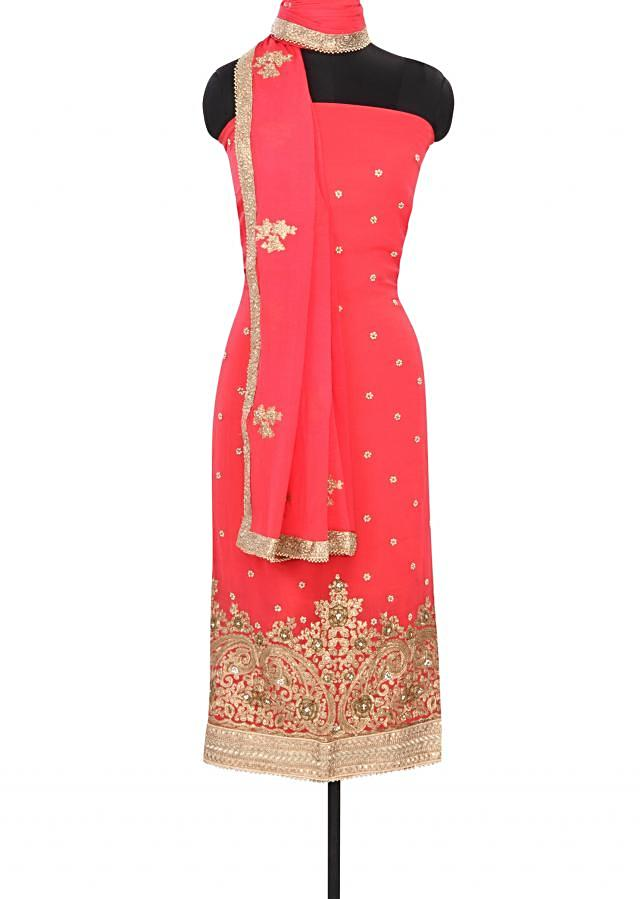 Coral pink unstitched suit embellished in zari and kundan embroidery only on Kalki