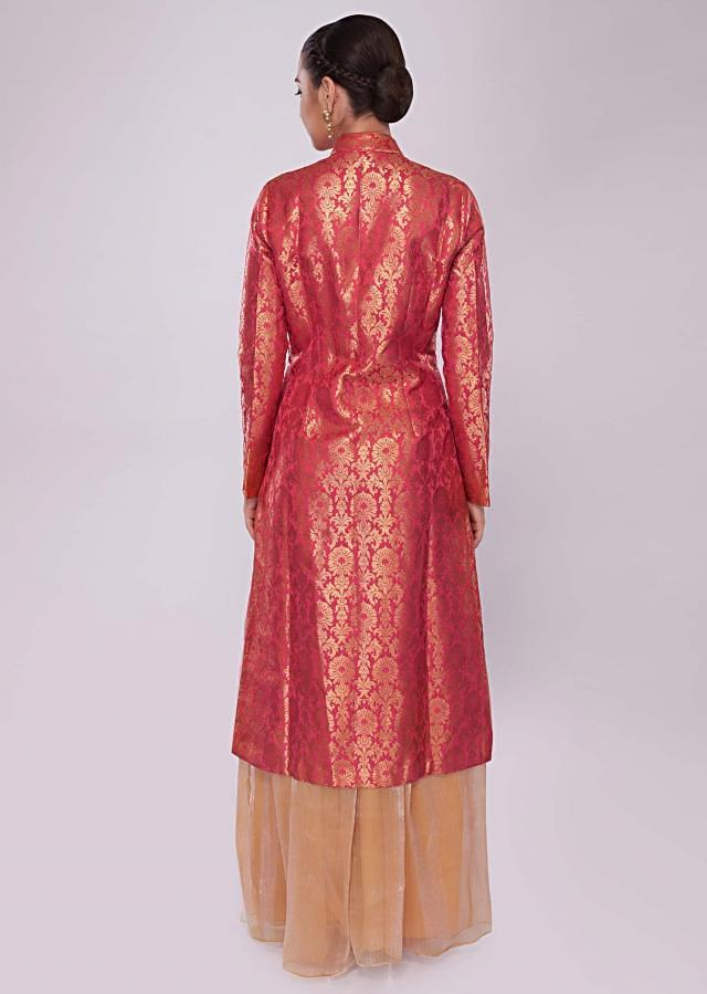 Coral red brocade suit paired with contrasting palazzo in fancy shimmer fabric only on Kalki