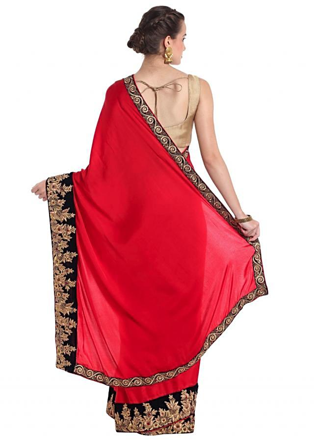 Coral red satin silk saree with zari work and french knot border only on Kalki