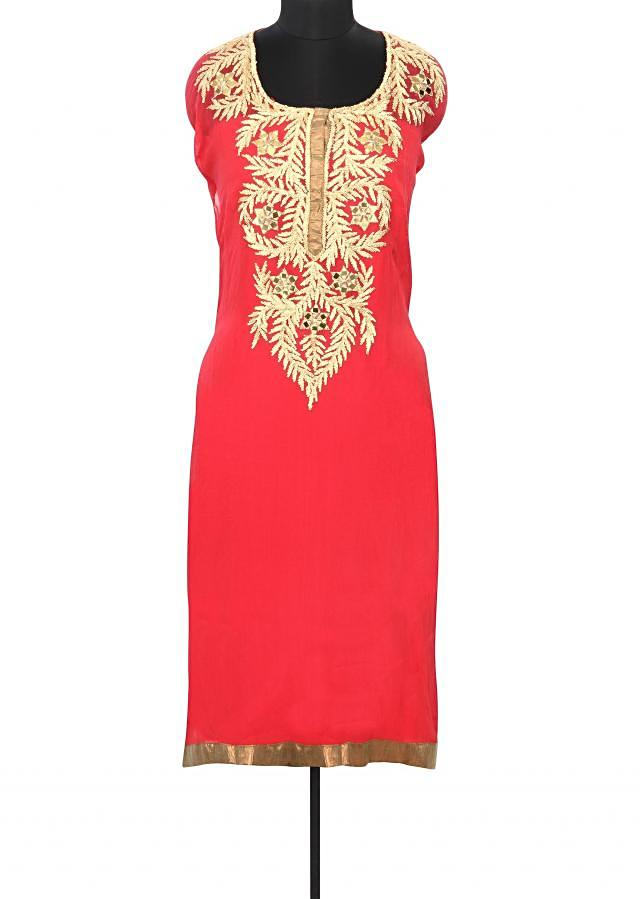 Coral semi stitched suit with embroidered neckline only on Kalki