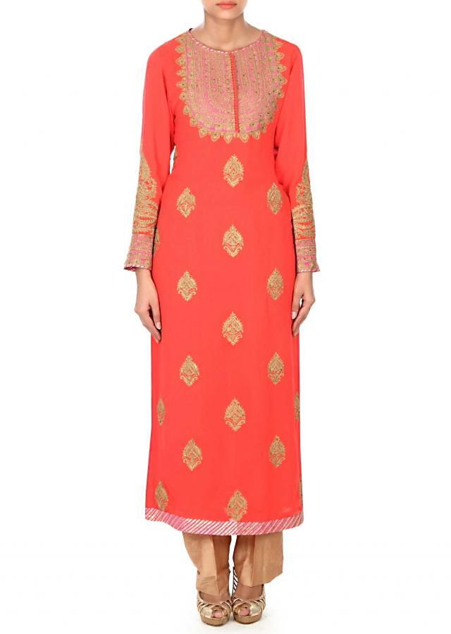 Coral straight suit adorn in zari butti only on Kalki
