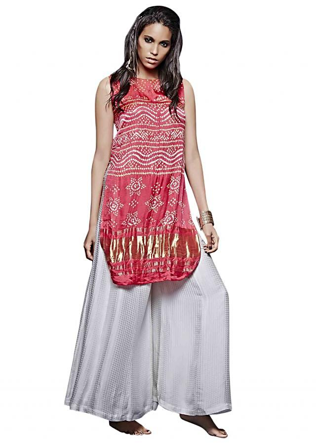 Coral tunic in bandhani with white palazzo pant only on Kalki