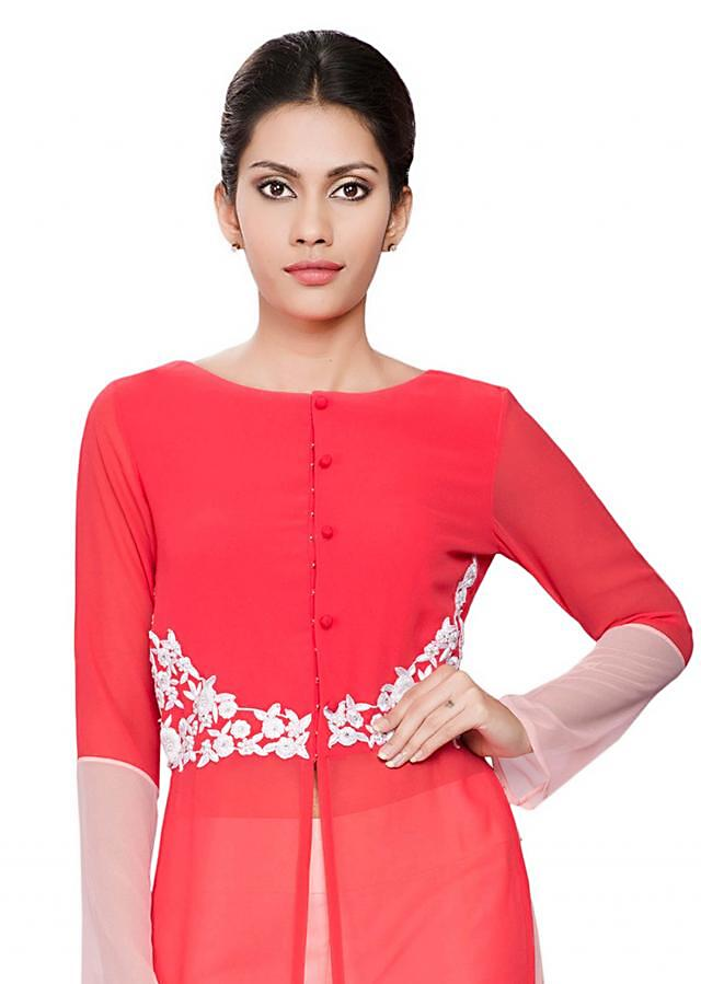 Coral tunic with onion pink cuffs and white embroidery