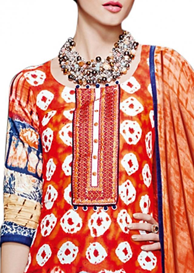 Coral unstitched suit enhanced in resham and print