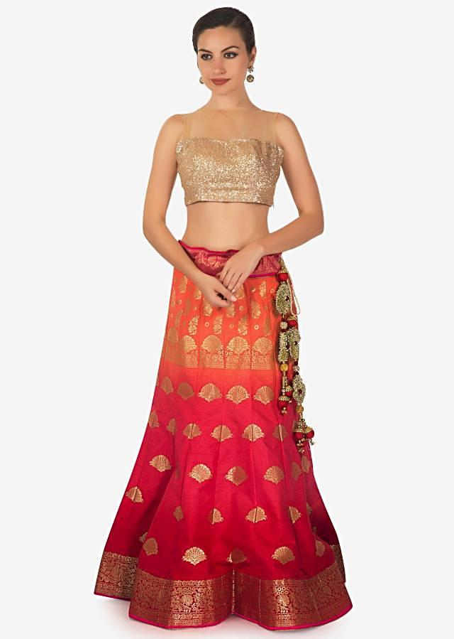 Coral and orange shaded lehenga in silk enhanced in weave embroidery only on Kalki