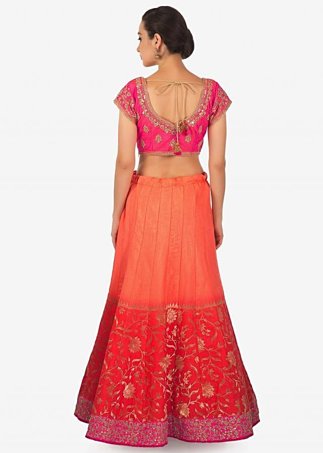 Coral and peach shaded lehenga matched with ready blouse only on Kalki