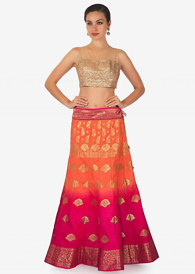 Coral and pink shaded lehenga in silk enhanced in weave embroidery only on Kalki