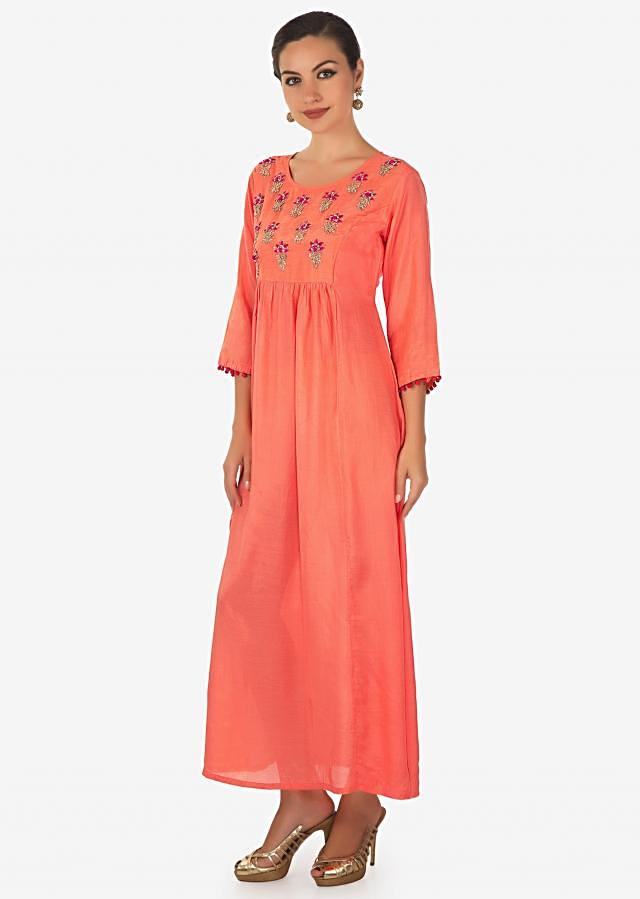 Coral long dress adorn in embroidered butti and gathers only on Kalki