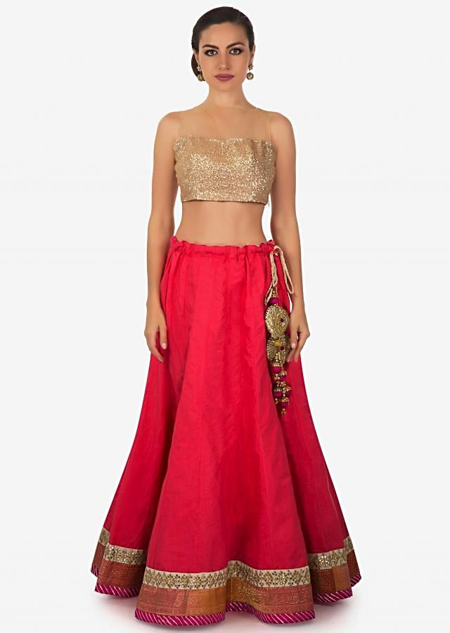 Coral pink lehenga with embroidered border and rani pink contrast dupatta only on Kalki