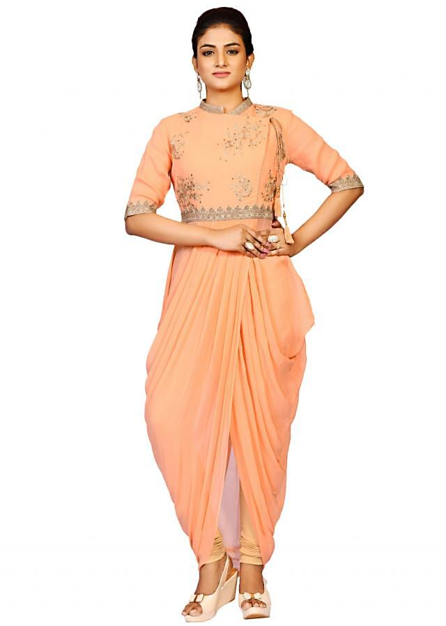 Coral dhoti pant suit in georgette enhanced in the aari embroidery only on Kalki