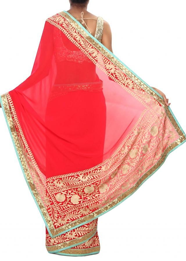 Coral red saree adorn in aari and sequin border only on Kalki