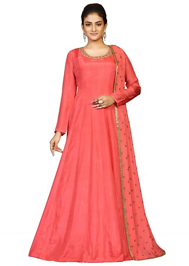 Coral silk suit with net dupatta embellished in antique embroidery only at Kalki.