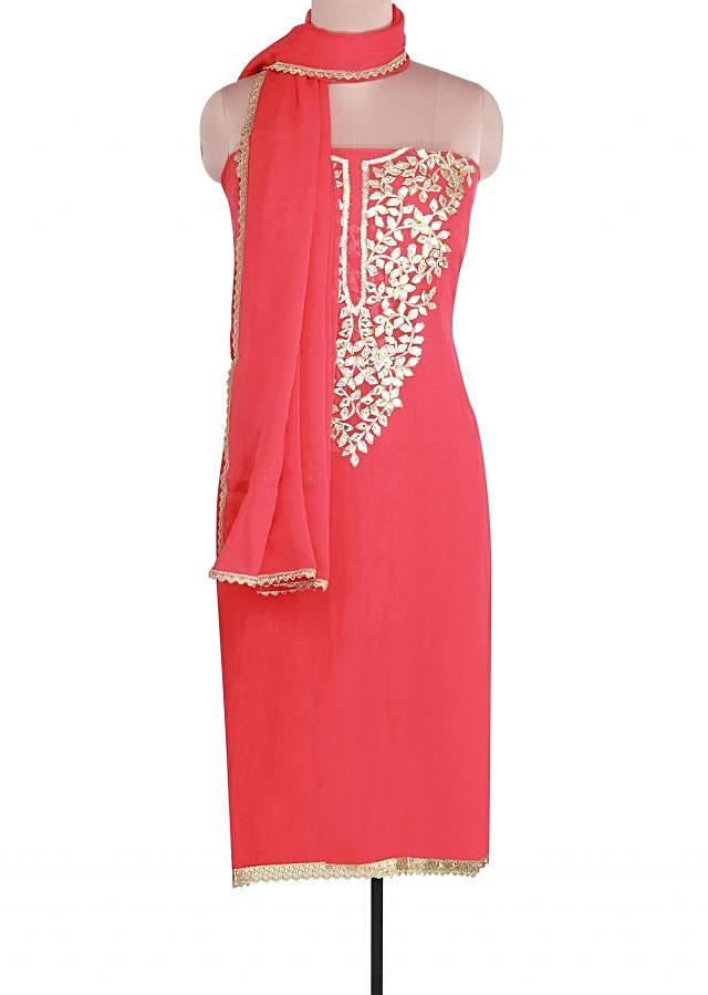 Coral unstitched suit adorn in applique embroidery only on Kalki