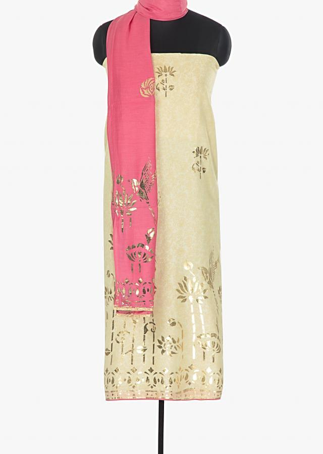 Cotton ivory unstitched suit with pink foil printed butti dupatta only on Kalki