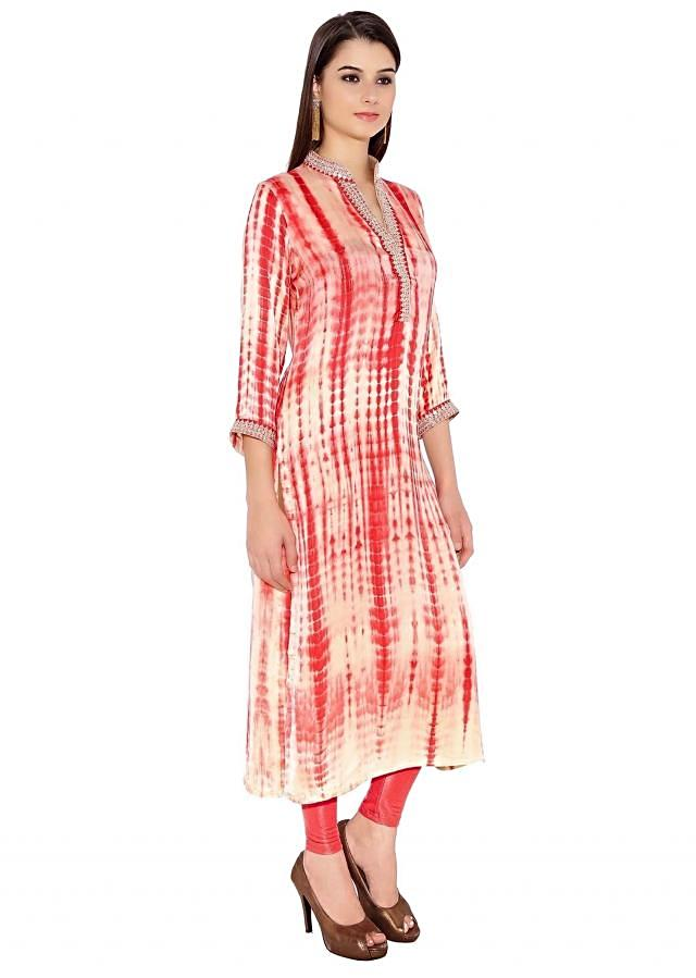 Cream & Coral Satin Silk Kurti With Abstract Print And Sequin Lace On Neck And Sleeves Only On Kalki
