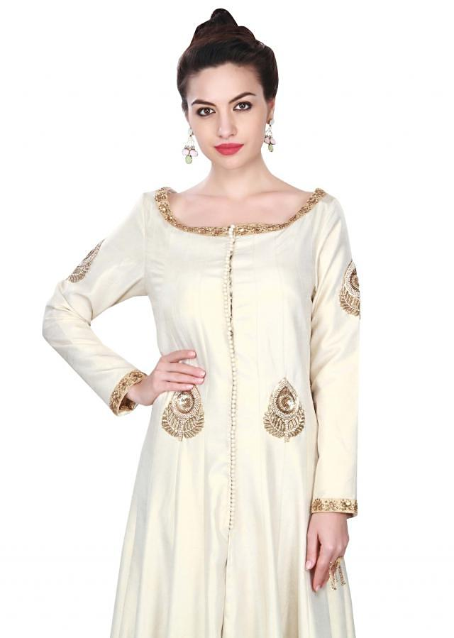 Cream anarkali suit adorn in French knot embroidery only on Kalki