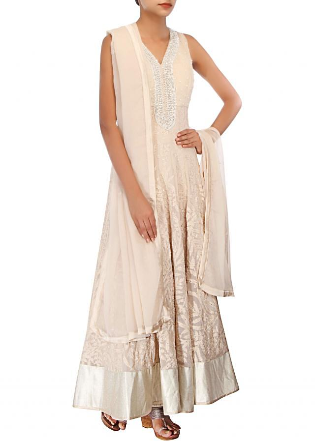 Cream anarkali suit adorn in stone and pearl embroidery only on Kalki