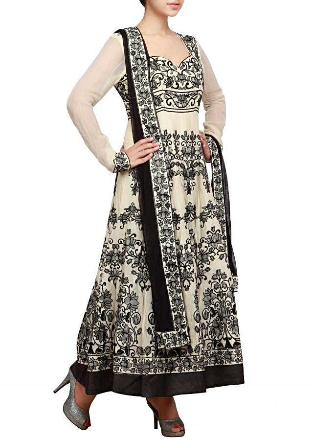 Cream anarkali suit embellished in thread embroidery all over only on Kalki