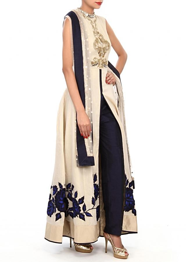 Cream anarkali suit embellished in zari and mirror embroidery only on Kalki